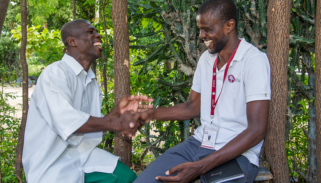 FINCA Haiti client with his loan officer